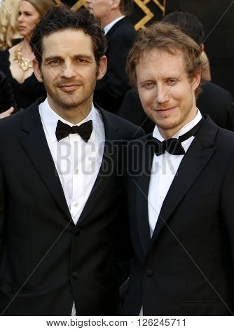 Laszlo Nemes and Geza Rohrig at the 88th Annual Academy Awards held at the Dolby Theatre in Hollywood, USA on February 28, 2016.