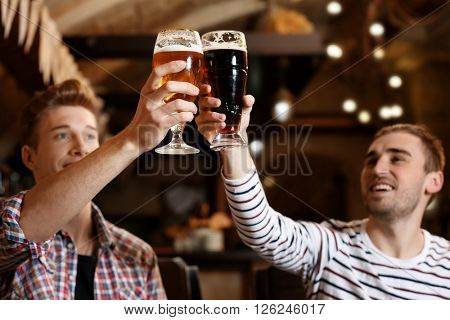 Two friends spending time in bar