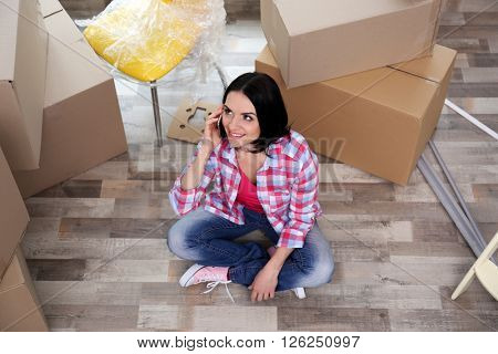Young woman on the floor of her new house. Close up.