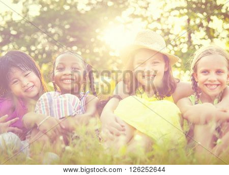 Group of Little Girls Smiling Park Concept