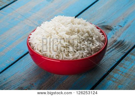 cooked white rice in a bowl, plain basmati rice, cooked basmati rice served in a colourful ceramic bowl