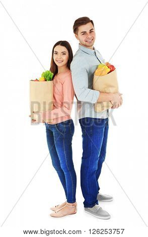 Young couple with paper bags of products isolated on white
