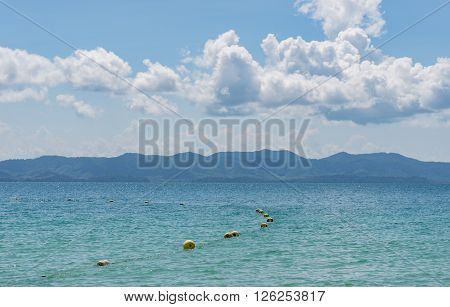 Tropical sea and island in summer, buoyancy floating on the sea