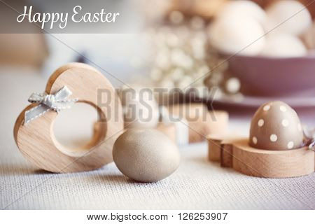 Easter  eggs in wooden stands, close up.Retro stylization