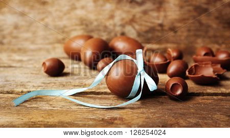 Chocolate Easter eggs on wooden background. Retro stylization