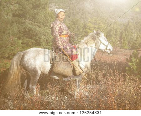 Woman Riding A Horse In A Scenic View Concept