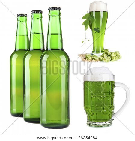 Different types of  green beer in glass, mug and bottles, isolated on white