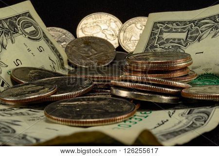 Savings thrift poverty taxes riches couch cushion money dollars dimes nichols and quarters