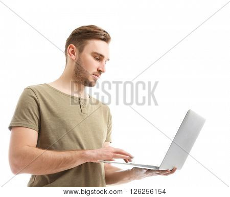 Young man using laptop, isolated on white