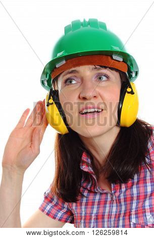 Female construction worker can not hear because wearing green helmet and protective headphones safety at work and ear protection. White background