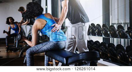 Couple Exercising Gym Workout Concept