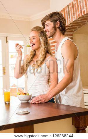 Cute couple having breakfast in the kitchen
