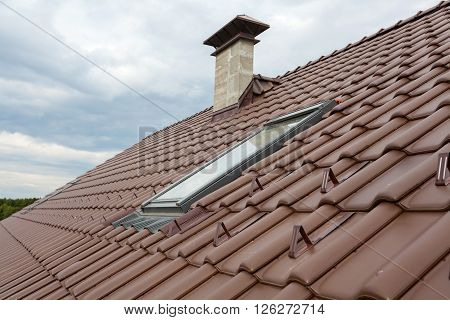 New roof with skylight natural red tile and chimney