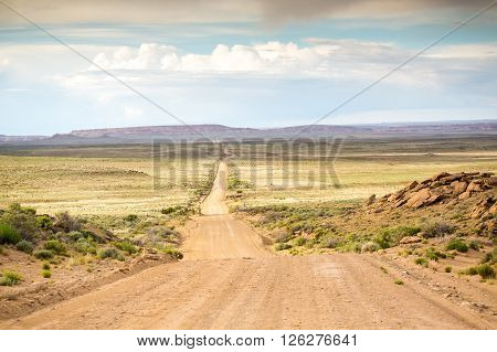 Long straight dirt road leading to Chaco Canyon New Mexico