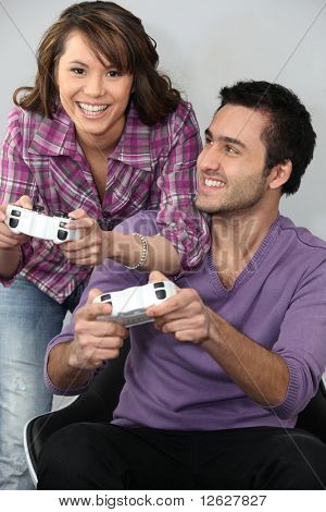 Young couple having fun with a video game