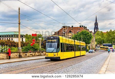City tram on Augustus bridge in Dresden - Germany