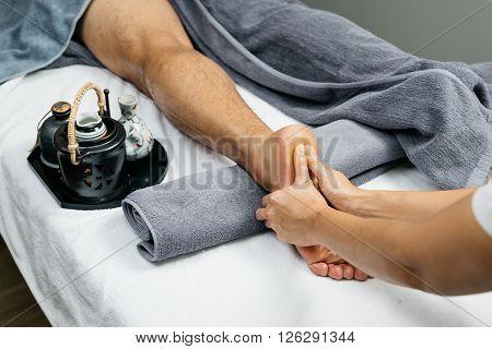 Massage series : Closeup of foot and leg massage