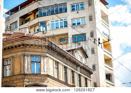 SARAJEVO, BOSNIA and HERZOGOVINA - CIRCA JUNE 2015: Buildings with holes from bullets in Sarajevo. From 1992 to 1996 the city suffered during the Bosnian War