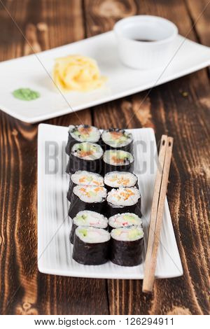 Maki sushi set with ginger wasabi and soy sauce. Shallow dof