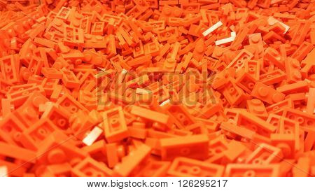 Many orange plastic block pieces heaped together