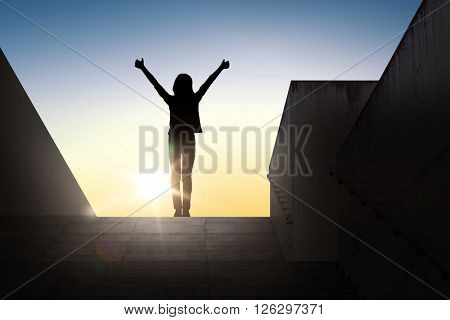 gesture, success, achievement and people concept - happy young woman or teenage girl silhouette showing thumbs up with both hands standing on stairs over sun light background