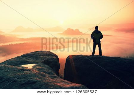 Moment Of Loneliness. Man On The Rock Empires  And Watch Over The Misty And Foggy Morning Valley To