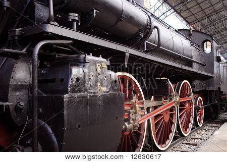 Locomotive with red wheels.