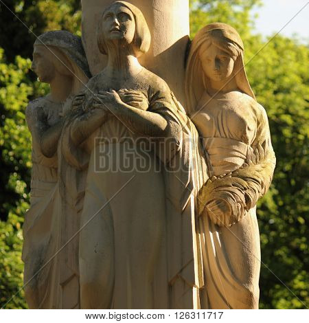 statue of three women as a symbol of time - past present and future