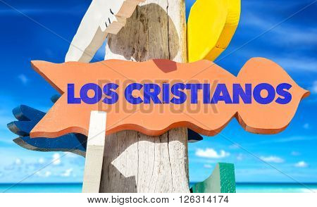 Los Cristianos signpost with beach background