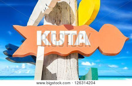 Kuta signpost with beach background