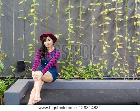 Beautiful Asian Girl Sitting In Art Cafe Shop