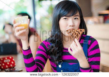 Young Asian Beautiful Woman Drinking Fresh Orange Juice