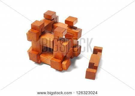 Classic wooden puzzle isolated on white background