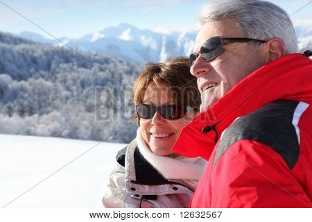 Portrait of a senior man and a senior woman in snow