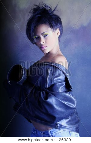 Teenage African American, High Fashion Shot Of Black Girl Wearing A Leather Jacket