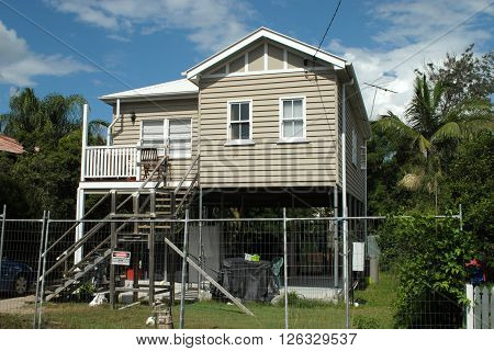BRISBANE, AUSTRALIA, APRIL 13: A Queenslander house is raised to reach the legal ceiling height required to build another living space underneath in Brisbane, Queensland, on April 13, 2016.