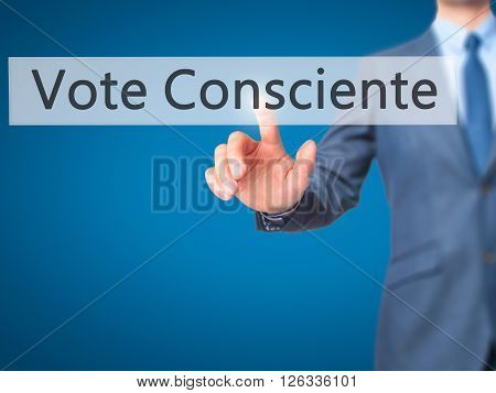Vote Consciente - Businessman Hand Pressing Button On Touch Screen Interface.