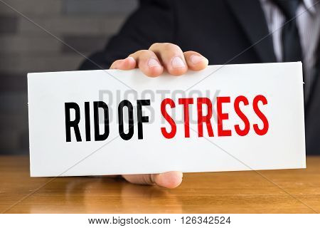 Rid of stress message on white card and hold by businessman