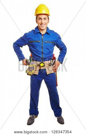 Smiling worker with blue overall and hardhat and a tool belt