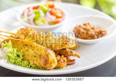 Grilled pork satay with peanut sauce and toast Thai food