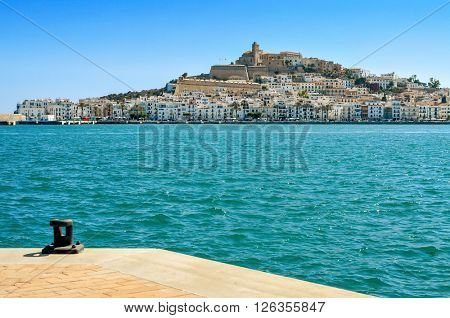 an empty mooring and the Mediterranean Sea, with Sa Penya and Dalt Vila districts, the old town of Ibiza Town, in the background, in the Balearic Islands, Spain