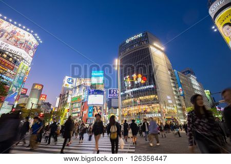Tokyo, Japan - November 6, 2015: Pedestrians cross at Shibuya Crossing on November 6th in Tokyo, Japan, 2015 . Shibuya Crossing is one of the busiest crosswalks in the world.