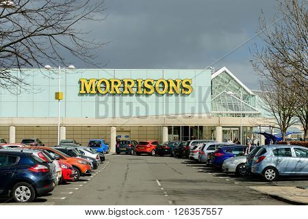 EDINBURGH SCOTLAND - APRIL 16 2016: Exterior view of the Morrisons supermarket and customer car park at the Gyle Centre located to the west of Edinburgh.
