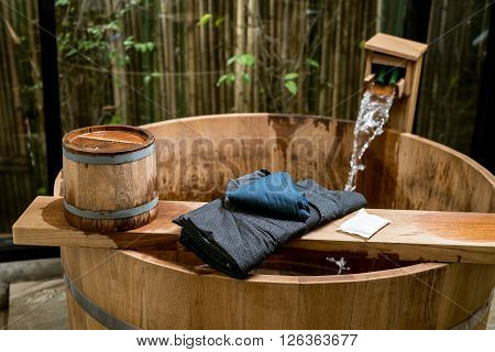 Onsen series : Blue yukata on wooden bathtub