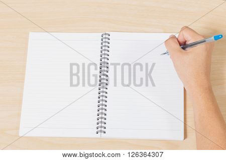 hand writting notebook with pen on wood table