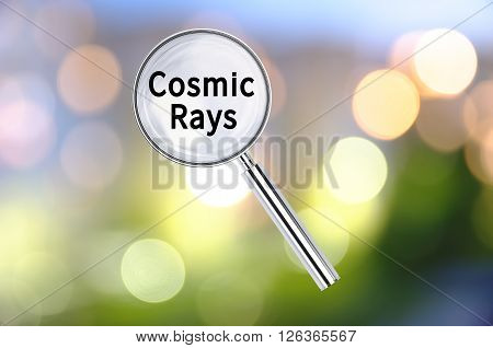 Magnifying lens over background with text Cosmic Rays, with the blurred lights visible in the background. 3d Rendering.