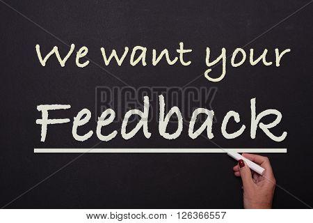 woman is writing on blackboard we want your feeback