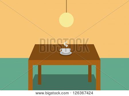 Káva na stole, v interéry a s lampou