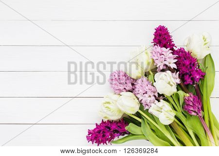 Bouquet Of Pink Hyacinth Flowers And White Tulips On White Wooden Background. Top View, Copy Space