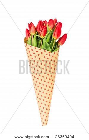 Bouquet Of Red Tulips Wrapped In Paper With Hearts. Isolated Over White Background
